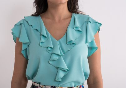 Tirkizna bluza sa karnerima